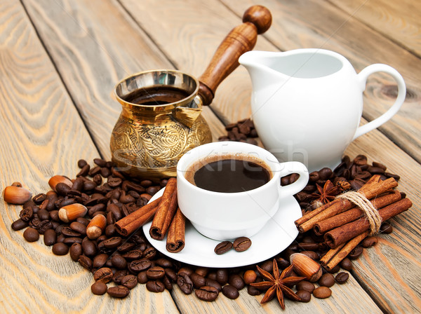 coffee cup with coffee beans,    milk jug and turk on a wooden b Stock photo © Es75