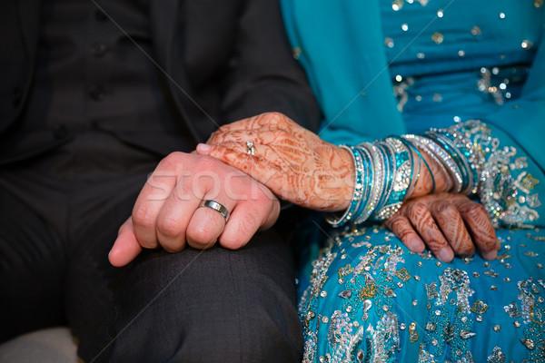 Kéz a kézben menyasszony vőlegény mutat gyűrűk család Stock fotó © esatphotography