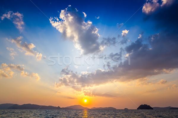 Naplemente nap tájkép háttér nyár óceán Stock fotó © esatphotography