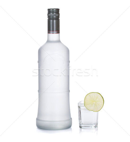 bottle of vodka with lime isolated on white Stock photo © Escander81