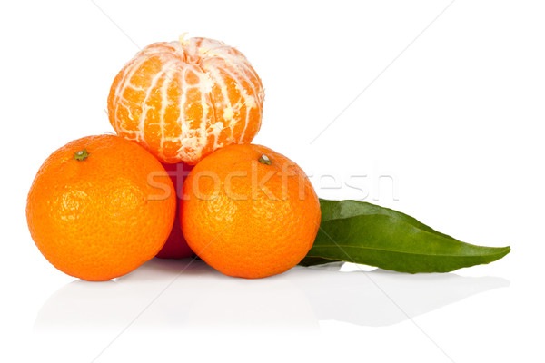 Fresh mandarine tangerine with leaves and segments isolated on w Stock photo © Escander81