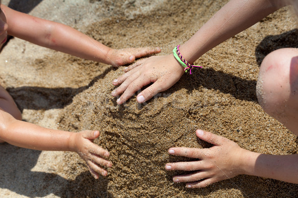 Children playing with sand. view from above Stock photo © Escander81