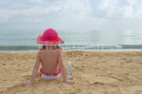 Adorable little girl at the beach watching the sea Stock photo © Escander81