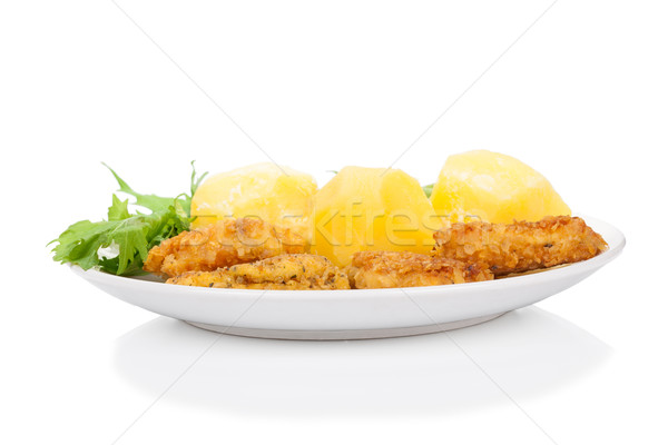Breaded chicken sticks with potato and mitsuna salad leaves on white Stock photo © Escander81