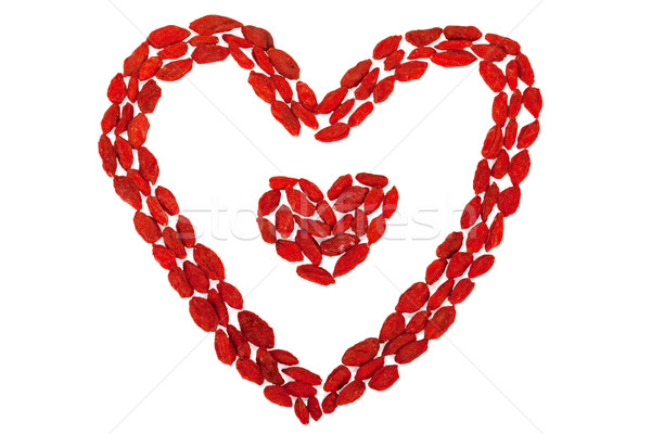 Goji berries heart shaped isolated on white Stock photo © Escander81