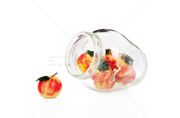 Marzipan apples in a glass jar isolated on white background Stock photo © Escander81