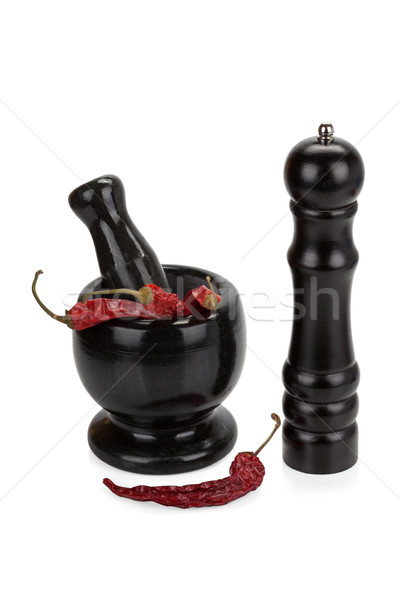Black marble mortar and pestle with red chilli pepper isolated o Stock photo © Escander81