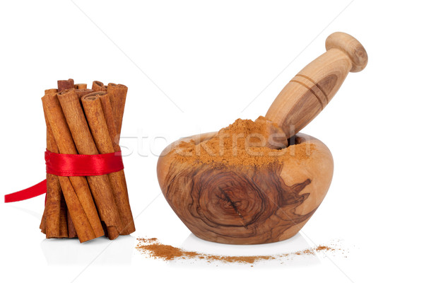 Cinnamon with mortar and pestle on white Stock photo © Escander81