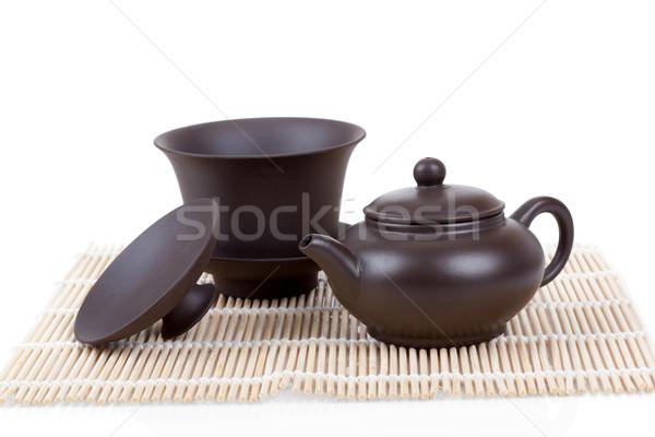 Chinese ceramic tea set bamboo mat isolated on white Stock photo © Escander81