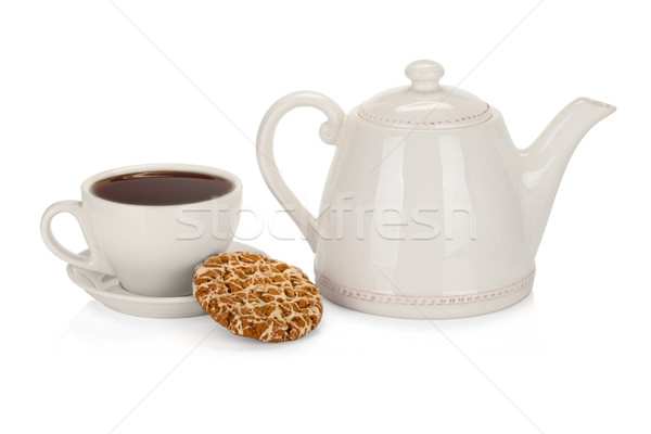 Cup of tea with teapot and a coockie on white Stock photo © Escander81