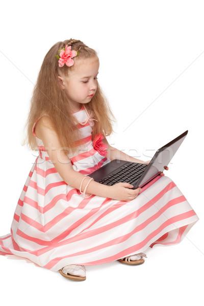 прелестный девочку ноутбука изолированный белый ребенка Сток-фото © Escander81