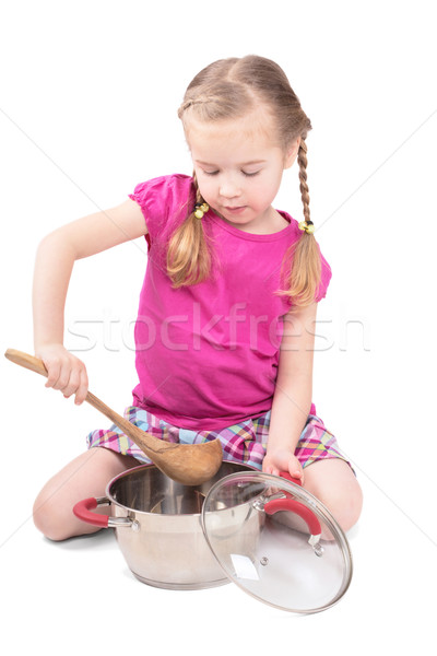 Adorable little girl cooking. isolated on white stock photo ... 2674e2ef8b46