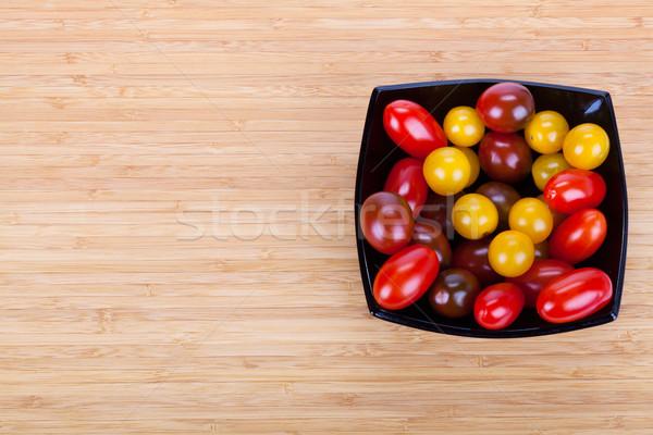 помидоров черный пластина деревянный стол Ломтики зеленый Сток-фото © Escander81
