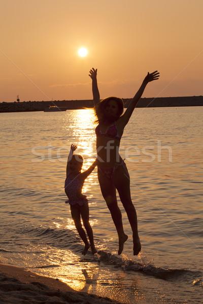 Lady девочку прыжки пляж лет Сток-фото © Escander81