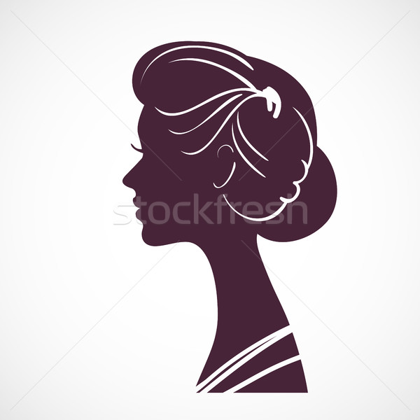 Women silhouette head with beautiful stylized hairstyle. Stock photo © ESSL