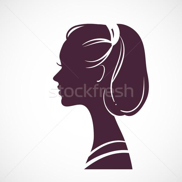 Women silhouette head with beautiful stylized haircut Stock photo © ESSL