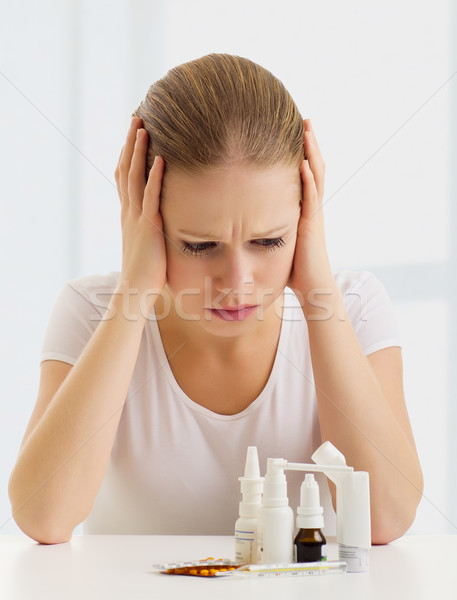 woman with a headache and flu and with medicines Stock photo © evgenyatamanenko