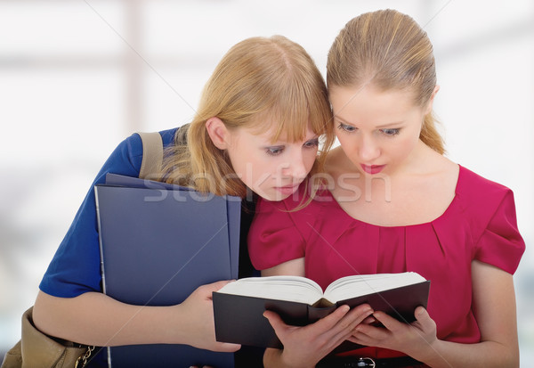 two cute girls college reading book Stock photo © evgenyatamanenko