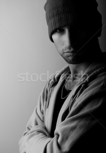 sad young man in a hat in the dark Stock photo © evgenyatamanenko