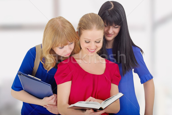 three nice girls college  discussing the book Stock photo © evgenyatamanenko