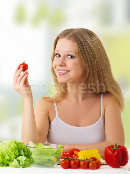 beautiful  girl with vegetables in the kitchen Stock photo © evgenyatamanenko