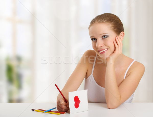 woman writes a love letter - a card for valentines day Stock photo © evgenyatamanenko