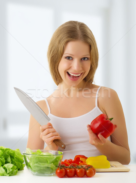 happy girl preparing vegetarian food, vegetables in the kitchen Stock photo © evgenyatamanenko