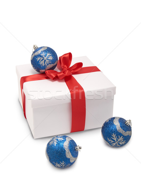 white box with red ribbon and Christmas decorations  Stock photo © evgenyatamanenko