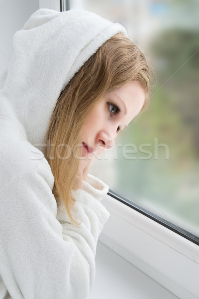 beautiful  young girl is sad at the window  Stock photo © evgenyatamanenko