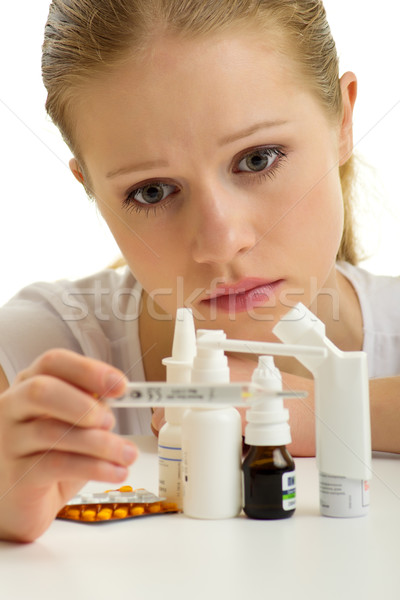 Genç kadın grip termometre hapları beyaz kadın Stok fotoğraf © evgenyatamanenko