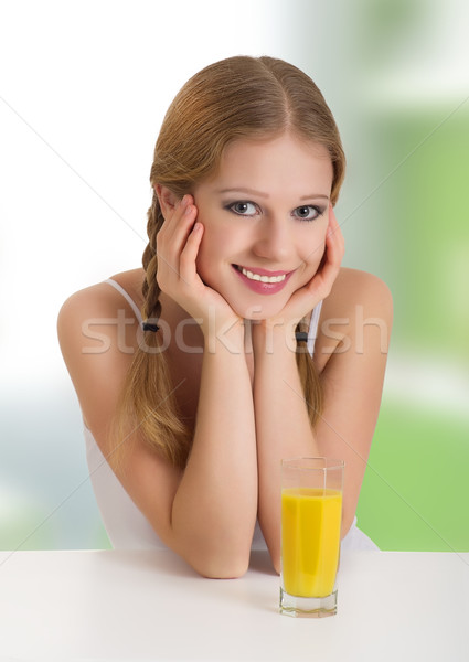 Bella felice ragazza succo d'arancia ritratto Foto d'archivio © evgenyatamanenko