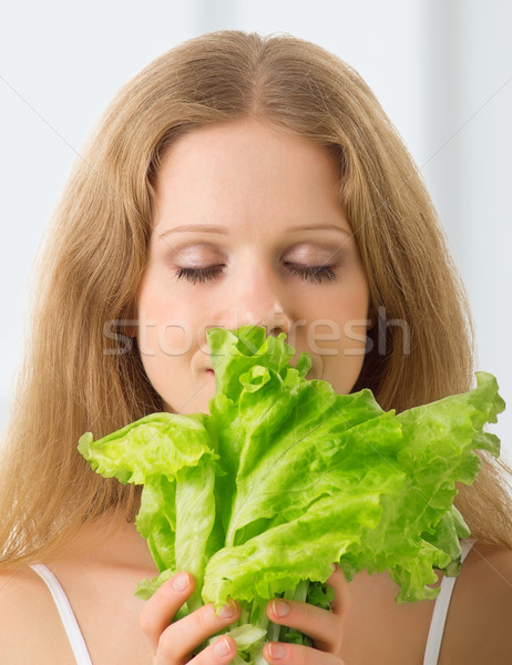 Young beautiful  woman with green lettuce Stock photo © evgenyatamanenko