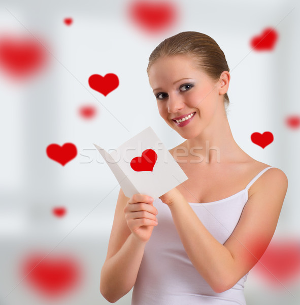 beautiful girl with  a postcard valentine   Stock photo © evgenyatamanenko