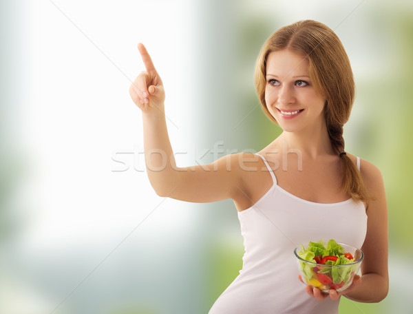 beautiful young  woman  with a salad choose healthy food Stock photo © evgenyatamanenko