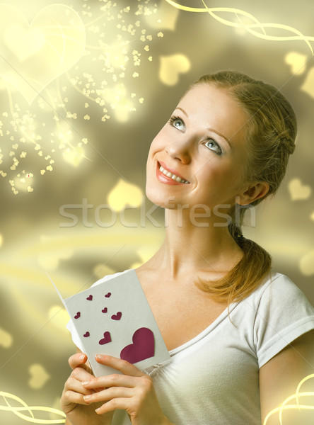 attractive happy girl , reading valentine card Stock photo © evgenyatamanenko