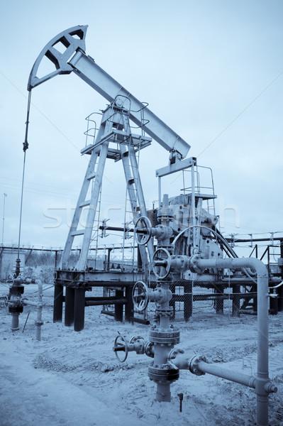 Pump jack and oilwell. Stock photo © EvgenyBashta