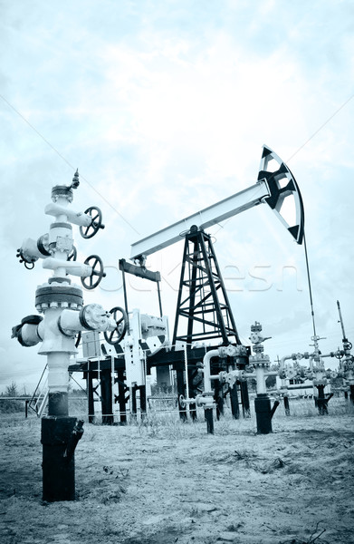 Pump jack and oilwell. Stock photo © EvgenyBashta