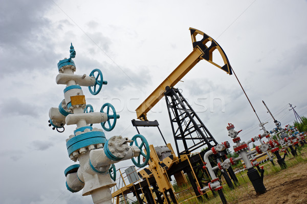 Pumpjack and oilwell. Stock photo © EvgenyBashta