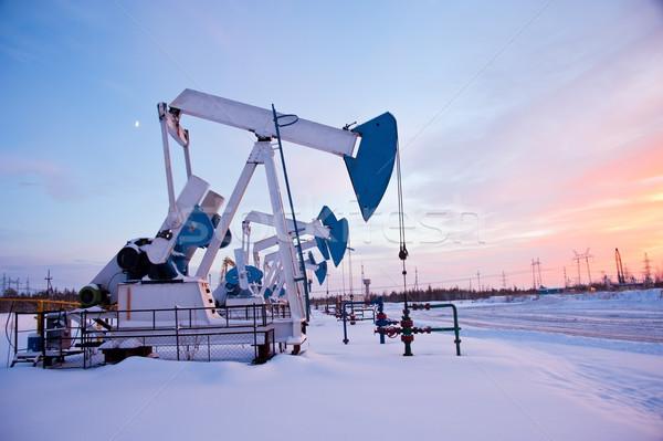 Stockfoto: Olie · zonsondergang · hemel · sneeuw · winter