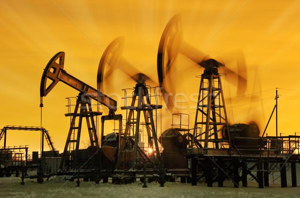 Three pump jacks. Stock photo © EvgenyBashta