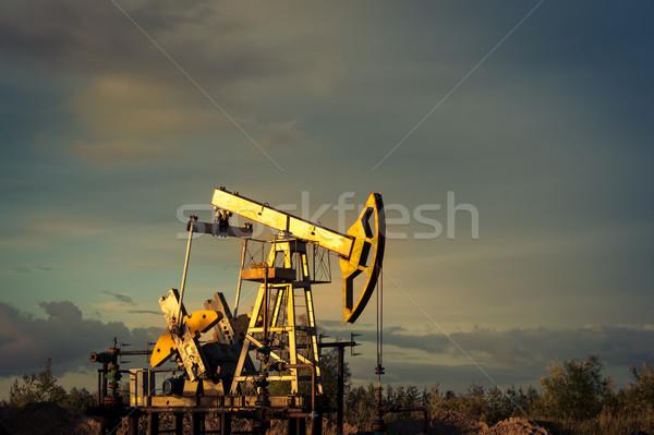 Petróleo bombear puesta de sol cielo industria energía Foto stock © EvgenyBashta