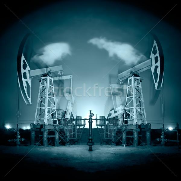 Oil Rigs at night. Stock photo © EvgenyBashta