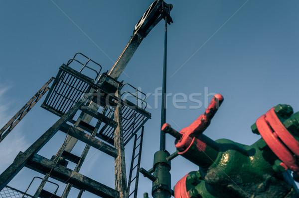 Group of wellhead. Oilfield with sand ground. Stock photo © EvgenyBashta