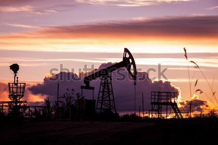 Olaj pumpa naplemente égbolt ipari energia Stock fotó © EvgenyBashta