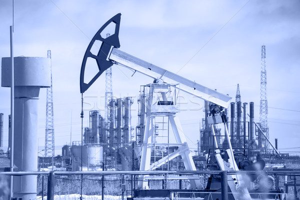 Pump jack and oil refinery. Stock photo © EvgenyBashta
