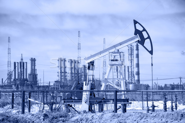 Pump jack and oil refinery. Toned. Stock photo © EvgenyBashta