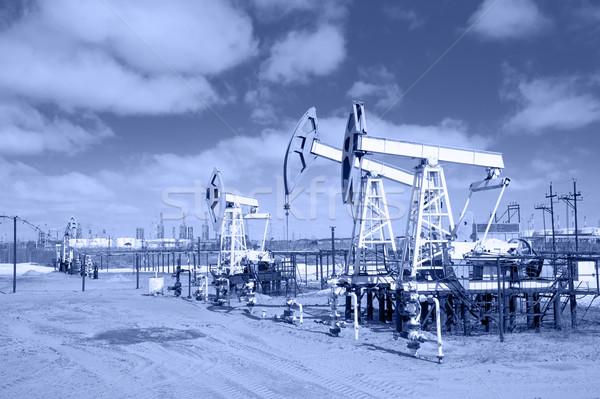 Pump jack on a oilfield. Toned. Stock photo © EvgenyBashta