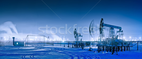 Winter night panoramic oil pumpjack. Stock photo © EvgenyBashta