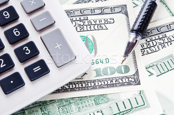 Usd számológép 100 dollár bankjegyek toll Stock fotó © EvgenyBashta