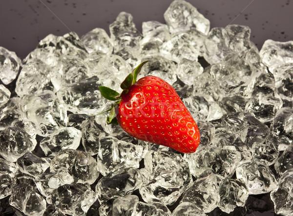 strawberry on black background.  strawberries with ice cubes on  Stock photo © EwaStudio